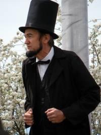 John Cooper as Abraham Lincoln