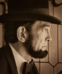 Ron Carley as Abraham Lincoln
